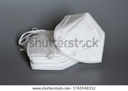 white KN95 or N95 masks for protection pm 2.5 and corona virus isolated on grey background. Prevention of the spread of virus and pandemic COVID-19.