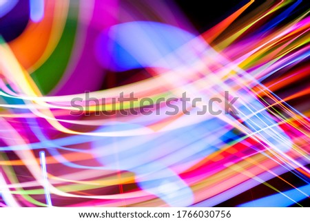 Colorful pattern of dynamic lines of light. Modern blurred background. Art concept of lighting effects. #1766030756
