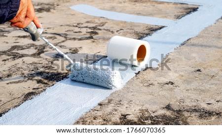 Hand painted gray flooring with paint rollers for waterproof, reinforcing net,Repairing waterproofing deck flooring. #1766070365