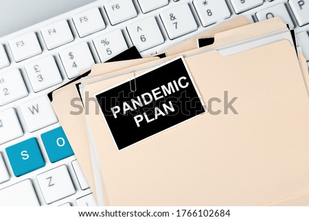 The words pandemic plan on the label on a computer keyboard. #1766102684
