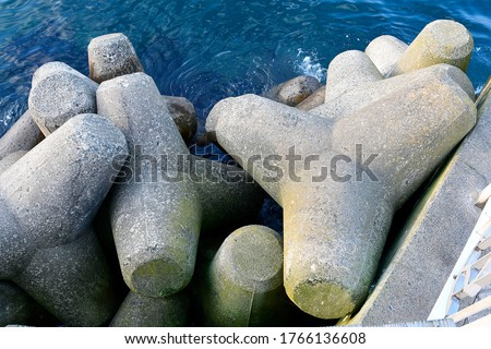 Concrete tetrapod with breakwaters will be placed on the coast to prevent land erosion caused by weather or waves from the sea. considered a concrete structure that helps to reduce wave forces well. #1766136608
