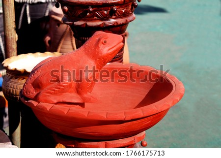 decorative Sculpture of frog in pot Made with Earthen Mud, handcrafted traditional clay decoration in Indian market #1766175713
