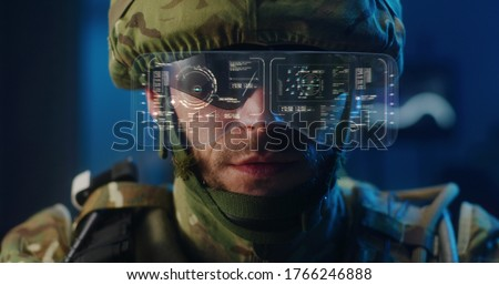 Close-up of a soldier using high-tech sunglasses with holographic display Royalty-Free Stock Photo #1766246888