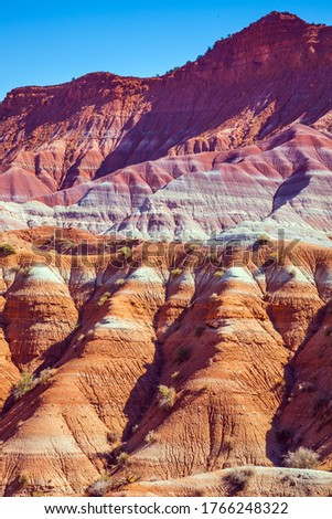 Arizona and Utah, USA. Paria Canyon-Vermilion Cliffs Wilderness Area. Huge slopes of red sandstone, striped from various inclusions of light rocks. The concept of active, extreme and photo tourism #1766248322