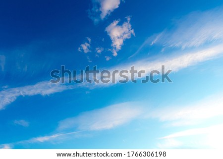 Blue clear sky with light cirrus clouds. High cloud cover and good weather. Atmospheric picture of heaven. Meteorology and climate.