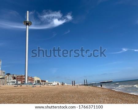 British airway i360 on Brighton beach front Royalty-Free Stock Photo #1766371100
