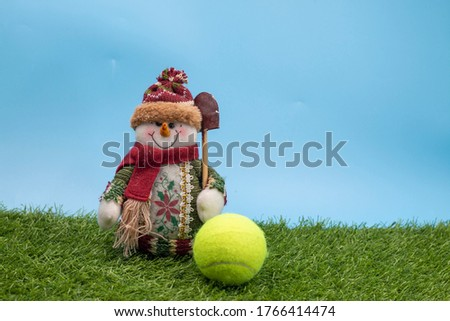 Tennis Christmas Holiday with Snowman and tennis ball on green grass #1766414474