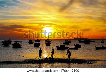 Sunset fishing at sea shore. Fishermen silhouettes at sunset. Sunset fisherman silhouette #1766449100