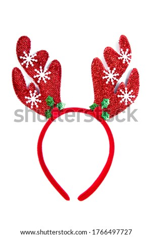 Red christmas headband isolated on white background. Fabric red christmas headband decoration with reindeer horn shape, snow and pine tree isolated