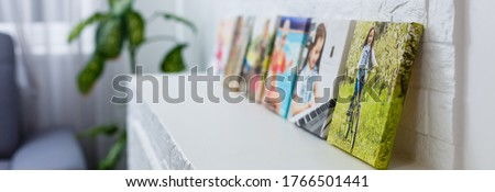 portraits of a little girl on a canvas photo Royalty-Free Stock Photo #1766501441
