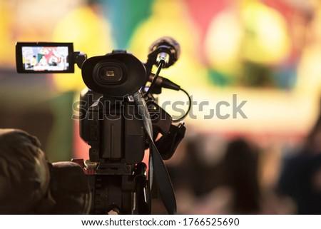Professional digital video camera equipment on event broadcasting. Royalty-Free Stock Photo #1766525690