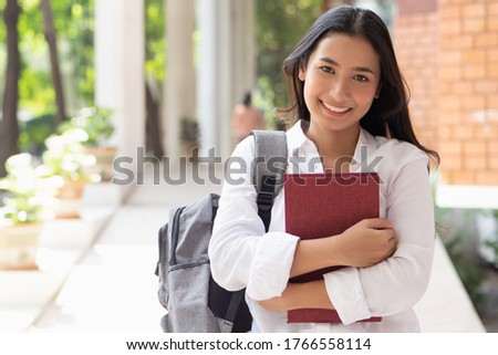 happy smiling asian woman college student Royalty-Free Stock Photo #1766558114