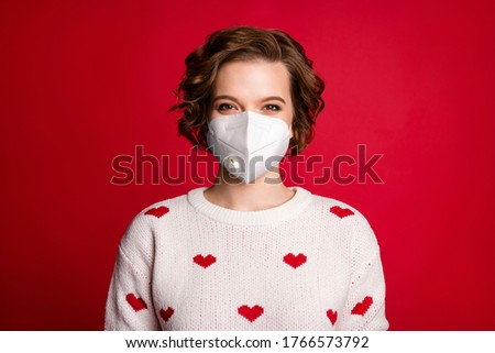 Close-up portrait of content lovely girl wearing safety n95 respirator mask 14-february white sweater with small hearts mers cov preventive measures isolated over vivid color background Royalty-Free Stock Photo #1766573792