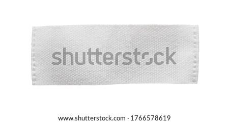 White blank clothing tag label isolated on white background