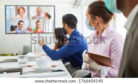 Conference call with video conference for Business Team Meeting in Covid-19 and Coronavirus Pandemie Royalty-Free Stock Photo #1766604140
