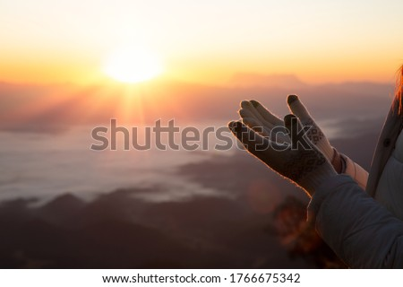 Religious young woman praying to God in the morning, spirtuality and religion, Religious concepts Royalty-Free Stock Photo #1766675342