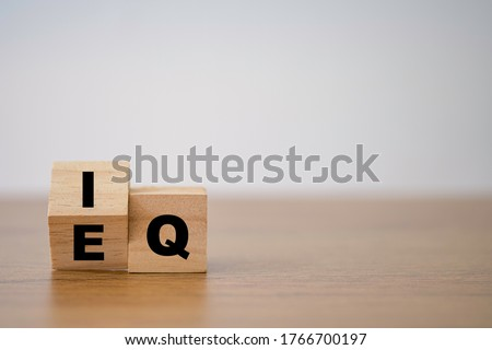 Flipping of EQ to IQ which print screen on wooden cube block. Smart idea and smart emotion concept. Royalty-Free Stock Photo #1766700197