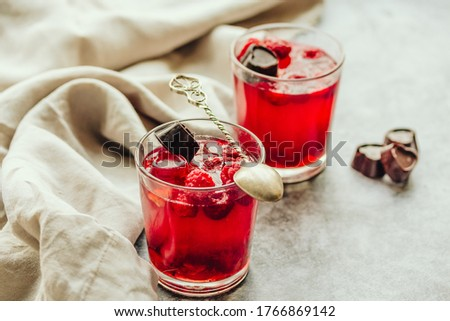 Close-up on glass cup berry fruit jelly pudding with fresh raspberries - summer dessert  in glasses on gray background. Diet dessert concept. Royalty-Free Stock Photo #1766869142