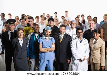 Variety of professionals standing together Royalty-Free Stock Photo #1766903684
