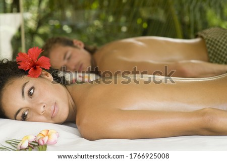 Young couple relaxing at spa #1766925008