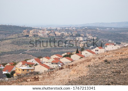 Ofarim Settlement and Palestinian Village (al)Luban and Rantis village on its background Royalty-Free Stock Photo #1767213341