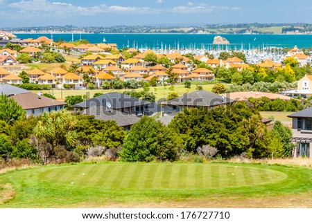 Residential area with marina on a background and a golf course on a foreground #176727710