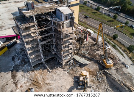 Aerial view of Building House Demolition and construction site Excavator with hydraulic crasher machine Royalty-Free Stock Photo #1767315287