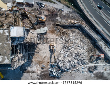 Aerial view of Building House Demolition and construction site Excavator with hydraulic crasher machine Royalty-Free Stock Photo #1767315296