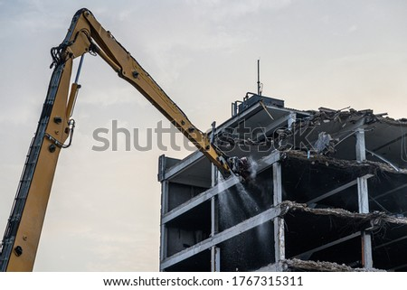 Building House destruction Demolition site Excavator with hydraulic crusher machine ruin house Royalty-Free Stock Photo #1767315311
