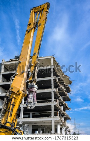 Building House Demolition site Excavator with hydraulic crasher machine and yellow container Royalty-Free Stock Photo #1767315323