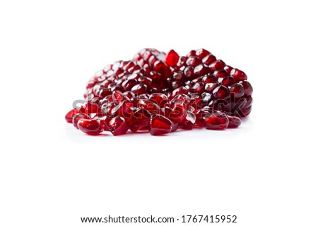 Pomegranate isolated on white background. Sweet and juicy garnet with copy space for text. Garnets isolated on white. Slices of garnets isolated on white background. #1767415952
