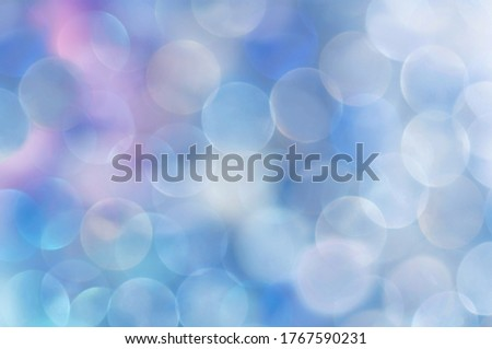 Multicolored bubbles in pastel colors, vertical background, layout for gift wrapping. Picture in blue shades.