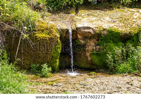 Source of clean water from the rock. Water geyser outdoors.