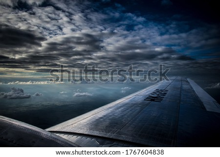 The wing of and old airplane, commonly used to reach hostil landing strips. #1767604838