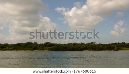 Landscape photo of Pelican Island from the water. Pelican Island is right next to Galveston Island.  #1767680615