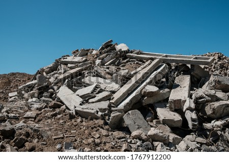 pile of concrete rubble from demolished building ruil to recycle construcion material   Royalty-Free Stock Photo #1767912200