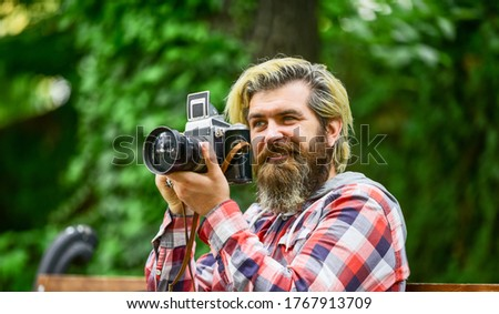 professional photographer use vintage camera. bearded man hipster take photo. photo shooting outdoor. brutal man traveler with retro camera. photography in modern life. travel tips.