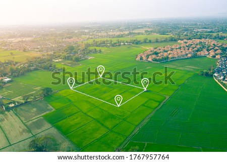 Land plot or land lot. Consist of aerial view of green field, position point and boundary line to show location and area. That is a tract of land for owned, sale, development, rent, buy or investment. #1767957764