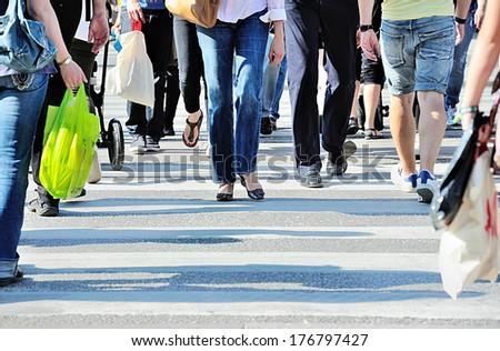 Diversified crowd crossing street