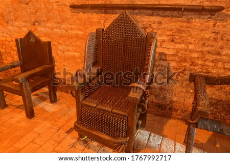 A torture device - the Iron Chair. The victim was seated on several strips or plates of brass and placed over an open flame and slowly roasted alive. #1767992717