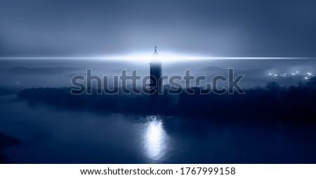 Beautiful night landscape with lighthouse at dark night  Royalty-Free Stock Photo #1767999158