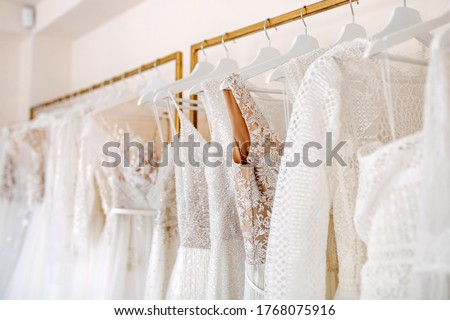 Bridal dresses collection at showroom. Luxury bridal gowns shop. Royalty-Free Stock Photo #1768075916