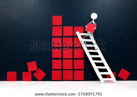 Rebuild, restart and recovery of economy concept. Human stick figure fixing broken building blocks. Royalty-Free Stock Photo #1768091741