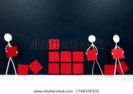 Teamwork, cooperation and rebuilding business concept. Human stick figures fixing broken building blocks. Royalty-Free Stock Photo #1768109102