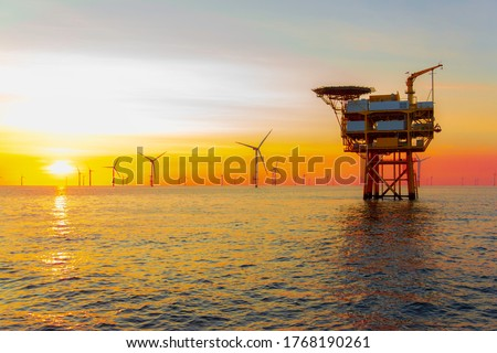 Beautiful sunset in the North Sea offshore wind farm Royalty-Free Stock Photo #1768190261