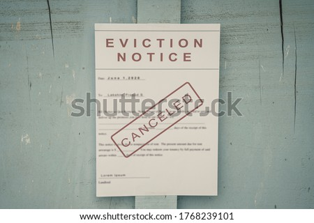 Canceled Foreclosed or eviction notice on a main door with blurred details of a house with vintage filter Royalty-Free Stock Photo #1768239101
