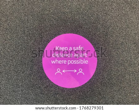 A floor sign says ' keep a safe distance apart where possible' during the Coronavirus pandemic.Social distancing.Image