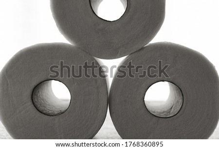 Black and white stark high contrast toilet paper rolls. High quality photo, back lit high key