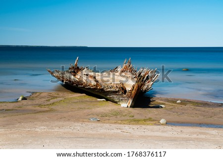 Ship wreck of Reketa. Wooden vessel rottening near Loksa in Estonia. Broken old boat photos. Drone images. Rusty and broken old vessel. Sunk ship in Baltic sea. Pictures taken on the beach #1768376117