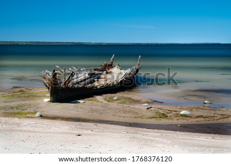 Ship wreck of Reketa. Wooden vessel rottening near Loksa in Estonia. Broken old boat photos. Drone images. Rusty and broken old vessel. Sunk ship in Baltic sea. Pictures taken on the beach #1768376120